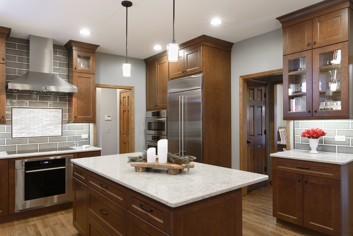 Soaring Cabinets, Quartz Countertops And Unique Tile Add Elegance